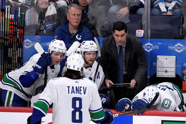 Vancouver Canucks' assistant coach Nolan Baumgartner speaks to players during a break in the first period of NHL action against the Winnipeg Jets, in Winnipeg on January 14, 2020. THE CANADIAN PRESS/Fred Greenslade