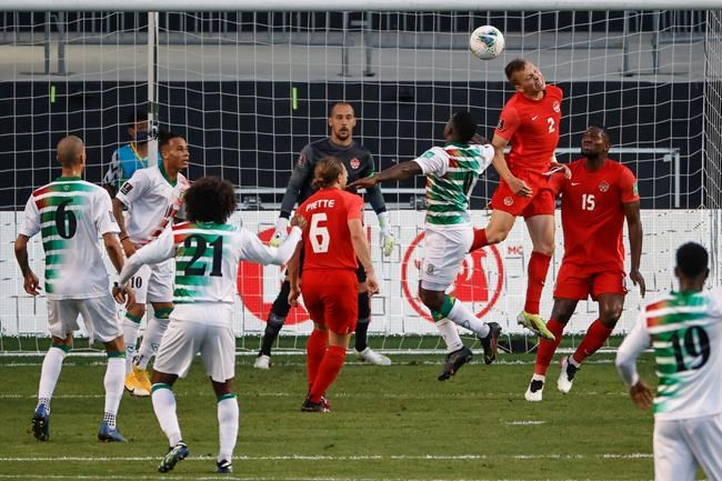 Canada's Alistair Johnston (2) goes for a header as he defends against Suriname during the first half of a World Cup 2022 Group B qualifying soccer match Tuesday, June 8, 2021, in Bridgeview, Ill. THE CANADIAN PRESS/AP-Kamil Krzaczynski