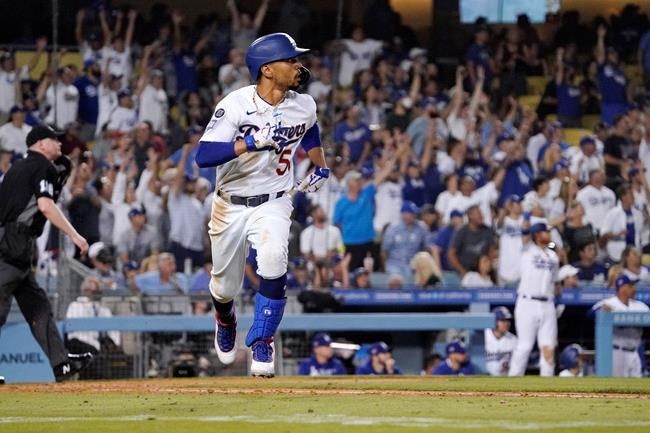 Los Angeles Dodgers' Mookie Betts runs to first after hitting a solo home run during the seventh inning of a baseball game against the Philadelphia Phillies Tuesday, June 15, 2021, in Los Angeles. (AP Photo/Mark J. Terrill)