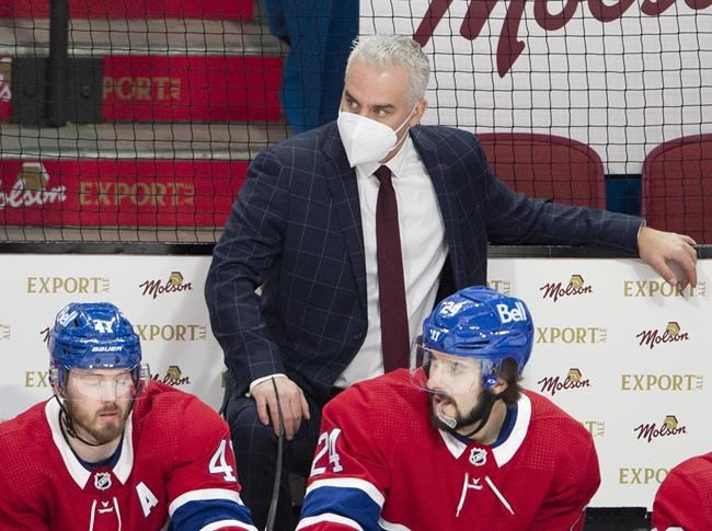 Montreal Canadiensinterim head coachDominique Ducharme keeps an eye on the action along with Paul Byron (41) and Phillip Danault (24) during second period NHL hockey action against the Ottawa Senators Tuesday, March 2, 2021 in Montreal.The Montreal Canadiens say Ducharme has been sent home and is isolating following irregularities in COVID-19 testing. THE CANADIAN PRESS/Ryan Remiorz