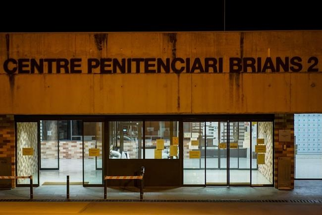 Entrance of Brians 2 penitentiary center in Sant Esteve Sesrovires, near Barcelona, northeast Spain, Wednesday, June 23, 2021. John McAfee, the creator of the McAfee antivirus software, has been found dead in his cell in a jail near Barcelona, a government official has told The Associated Press. Earlier Wednesday, a Spanish court issued a preliminary ruling in favor of his extradition to the United States to face tax-related criminal charges. Security personnel at the Brians 2 penitentiary near the northeastern Spanish city tried to revive McAfee, who was 75, but the jail's medical team finally certified his death, the regional Catalan government said. (AP Photo/Joan Mateu)