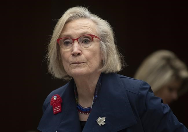 Crown-Indigenous Relations Minister Carolyn Bennett takes her seat as she wait to appear before the Indigenous and Northern Affairs committee in Ottawa on March 10, 2020.Bennett has apologized after she was called out for a one-word text message to Independent Member of Parliament Jody Wilson-Raybould.THE CANADIAN PRESS/Adrian Wyld