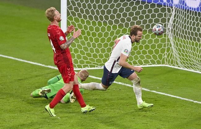 England's Harry Kane, right, reacts after scoring his team's second goal during the Euro 2020 soccer championship semifinal between England and Denmark at Wembley stadium in London, Wednesday, July 7, 2021. (Justin Tallis/Pool Photo via AP)