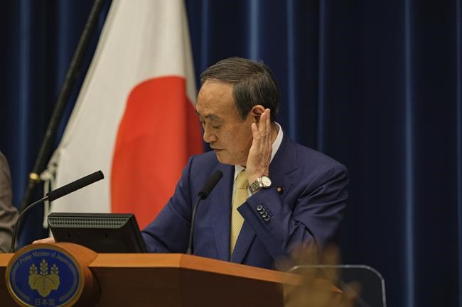 Japan's Prime Minister Yoshihide Suga speaks during a press conference at his official residence in Tokyo, Thursday, July 8, 2021. Suga declared the fourth state of emergency would go in effect on Monday and last through Aug. 22. This means the Olympics, opening on July 23 and running through Aug. 8, will be held entirely under emergency measures. (Nicolas Datiche/Pool Photo via AP)