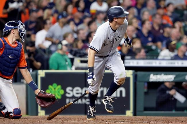 New York Yankees' DJ LeMahieu drops his bat as he watches his two-run double in front of Houston Astros catcher Jason Castro during the seventh inning of a baseball game Friday, July 9, 2021, in Houston. (AP Photo/Michael Wyke)
