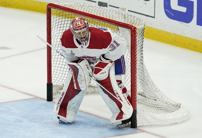 Montreal Canadiens goaltender Carey Price watches from the net during pregame of Game 5 of the NHL hockey Stanley Cup finals against the Tampa Bay Lightning, Wednesday, July 7, 2021, in Tampa, Fla. THE CANADIAN PRESS/AP-Gerry Broome