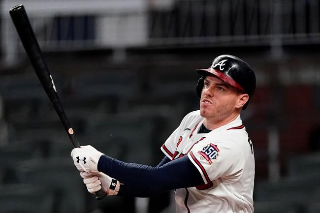 Atlanta Braves first baseman Freddie Freeman (5) hits a solo home run in the sixth inning of a baseball game against the San Diego Padres Tuesday, July 20, 2021, in Atlanta. (AP Photo/John Bazemore)