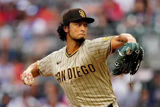 San Diego Padres starting pitcher Yu Darvish works in the first inning of a baseball game against the Atlanta Braves Tuesday, July 20, 2021, in Atlanta. (AP Photo/John Bazemore)