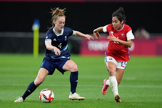 Britain's Keira Walsh and Chile's Yessenia Lopez compete for the ball during a women's soccer match at the 2020 Summer Olympics, Wednesday, July 21, 2021, in Sapporo, Japan. (AP Photo/Silvia Izquierdo)
