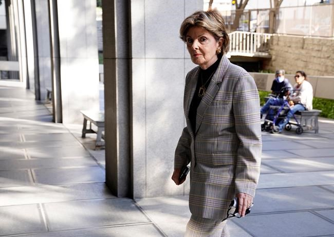Attorney Gloria Allred enters the Clara Shortridge Foltz Criminal Justice Center for an expected arraignment hearing for Harvey Weinstein, the 69-year-old convicted rapist and disgraced movie mogul, on additional sexual assault charges in California, Wednesday, July 21, 2021, in Los Angeles. (AP Photo/Chris Pizzello)