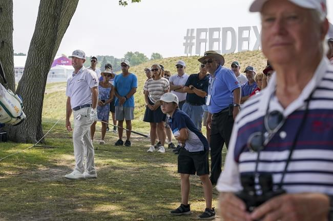 Chez Reavie, left, watches as his shot from the rough lands along the 18th fairway during the second round of the 3M Open golf tournament in Blaine, Minn., Friday, July 23, 2021. (AP Photo/Craig Lassig)
