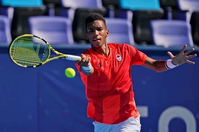Felix Auger-Aliassime, of Canada, plays against Max Purcell, of Australia, during the first round of the tennis competition at the 2020 Summer Olympics, Sunday, July 25, 2021, in Tokyo, Japan. THE CANADIAN PRESS/AP/Seth Wenig