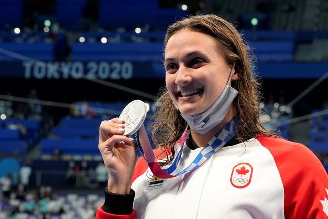 Canada's Kylie Masse poses with her silver medal won in the women's 100m backstroke final event during the Tokyo Summer Olympic Games, in Tokyo, Tuesday, July 27, 2021. THE CANADIAN PRESS/Frank Gunn