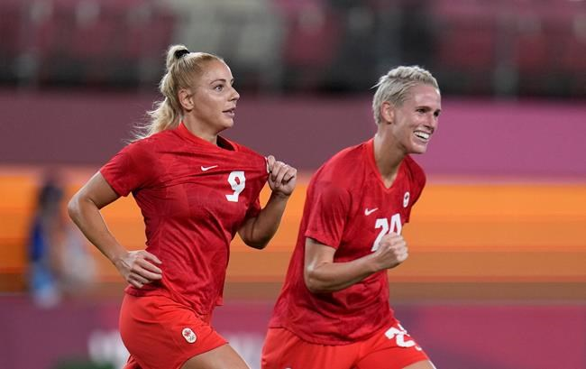 Canada's Adriana Leon, left, celebrates with teammate Sophie Schmidt after scoring her side's opening goal against Great Britain during a women's soccer match at the 2020 Summer Olympics, Tuesday, July 27, 2021, in Kashima, Japan. THE CANADIAN PRESS/AP/Fernando Vergara