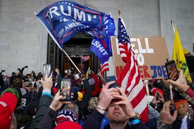 In this Jan. 6, 2021, file photo, Trump supporters gather outside the Capitol in Washington.A group of Capitol Hill and D.C. police officers are on the witness stand as the long-awaited hearings into the Jan. 6 riot get underway. THE CANADIAN PRESS/AP/John Minchillo, File
