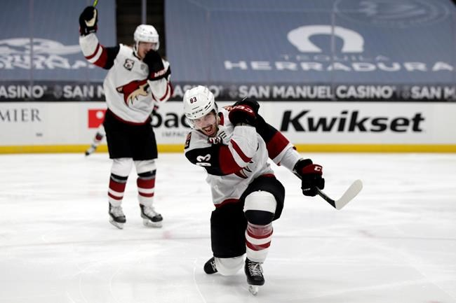 Arizona Coyotes right wing Conor Garland, right, celebrates after scoring against the Anaheim Ducks, next to right wing Clayton Keller during the first period of an NHL hockey game in Anaheim, Calif., Thursday, March 18, 2021. THE CANADIAN PRESS/AP-Alex Gallardo