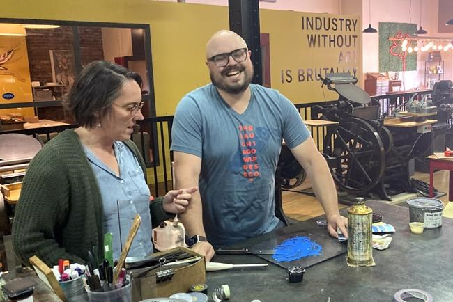 Andrea Lanich, left, and her husband, Joe Lanich, operate a letterpress print shop called The Laughing Owl Press Co. in Kane, Pa. Joe Lanich says he was surprised that two residents of the Kane area, restaurant owner Pamela Bauer and her friend William Blauser Jr., were arrested in May on charges stemming from the Jan. 6 riot at the U.S. Capitol. (AP Photo/Michael Kunzelman)