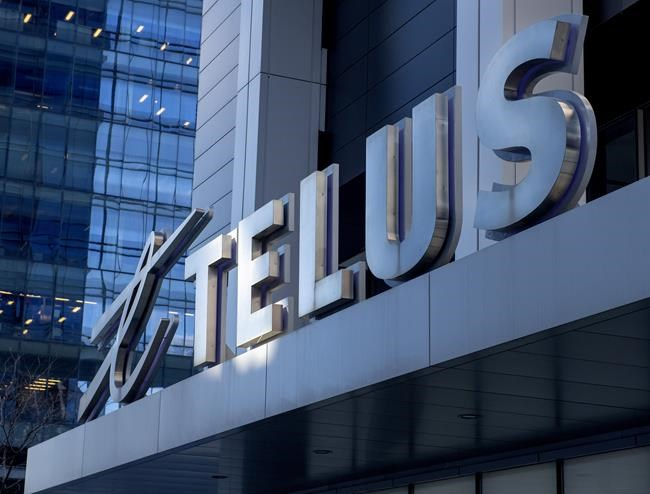 The sign on the front of the Telus head office is shown in Toronto, Thursday, Feb. 11, 2021. THE CANADIAN PRESS/Frank Gunn