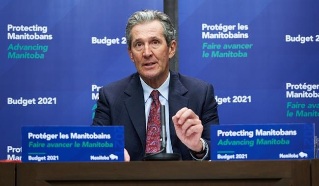 Premier of Manitoba Brian Pallister speaks at a news conference in Winnipeg on Wednesday, April 7, 2021. THE CANADIAN PRESS/David Lipnowski