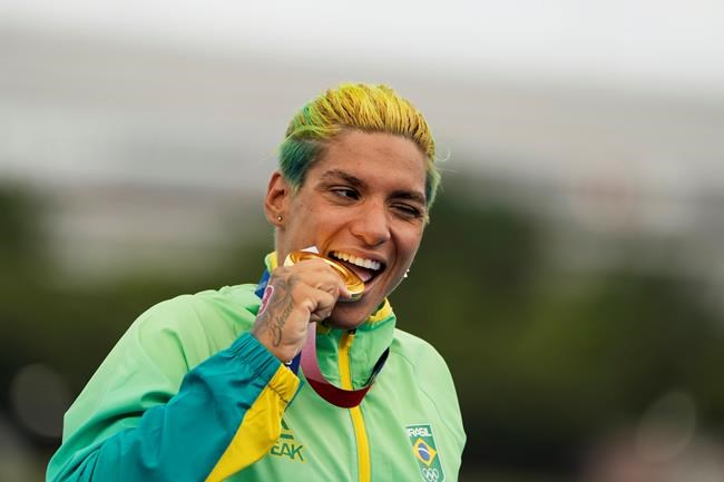 Ana Marcela Cunha, of Brazil, poses with her gold medal after winning the women's marathon swimming event at the 2020 Summer Olympics, Wednesday, Aug. 4, 2021, in Tokyo. (AP Photo/David Goldman)