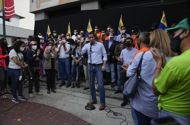 Venezuela opposition leader Juan Guaido speaks at a citizens' assembly to ask for the release of the opposition figure Freddy Guevara, a month of his arrest in Caracas, Venezuela, Thursday Aug. 12, 2021. (AP Photo/Ariana Cubillos)
