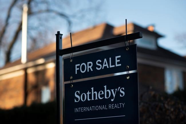 A real estate sale sign is shown in a west-end Toronto neighbourhood Saturday, March 7, 2020. THE CANADIAN PRESS/Graeme Roy