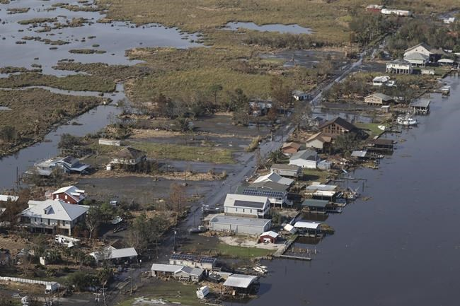 A view of flood damaged buildings are seen as President Joe Biden (not pictured) inspects the damage from Hurricane Ida on the Marine One helicopter during an aerial tour of communities in Laffite, Grand Isle, Port Fourchon and Lafourche Parish, Louisiana, Friday, Sept. 3, 2021. (Jonathan Ernst/Pool via AP)