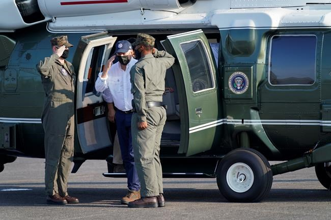 President Joe Biden steps from Marine One after an aerial tour of damage caused by Hurricane Ida, Friday, Sept. 3, 2021, at Port of South Louisiana Executive Regional Airport in Lafourche Parish in Reserve, La. (AP Photo/Evan Vucci)