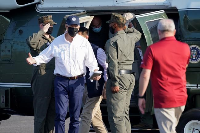 President Joe Biden walks from Marine One after an aerial tour and greets Rep. Steve Scalise, R-La., Friday, Sept. 3, 2021, at Port of South Louisiana Executive Regional Airport in Lafourche Parish in Reserve, La. (AP Photo/Evan Vucci)