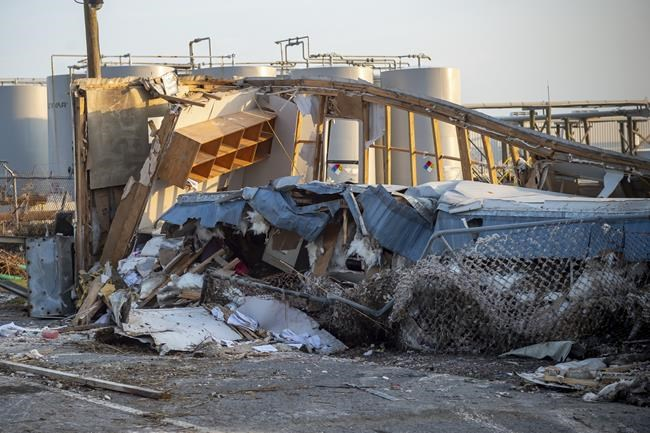 Hurricane Ida leaves behind destruction at Port Fouchon, La., Thursday, Sept. 2, 2021. Utility executives say more than 25,000 workers from 40 states are trying to fix damaged poles, more than 2,200 broken transformers and more than 150 destroyed transmission structures. Ida destroyed the city's electrical grid and left more than 1 million customers in Louisiana without power. (Scott Clause /The Daily Advertiser via AP)
