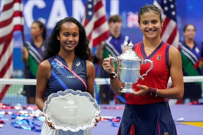 Leylah Fernandez (left ) and Emma Raducanu pose for photos after Raducanu defeated Fernandez in the women's singles final of the U.S. Open tennis championships on Saturday in New York. (Seth Wenig / The Associated Press)
