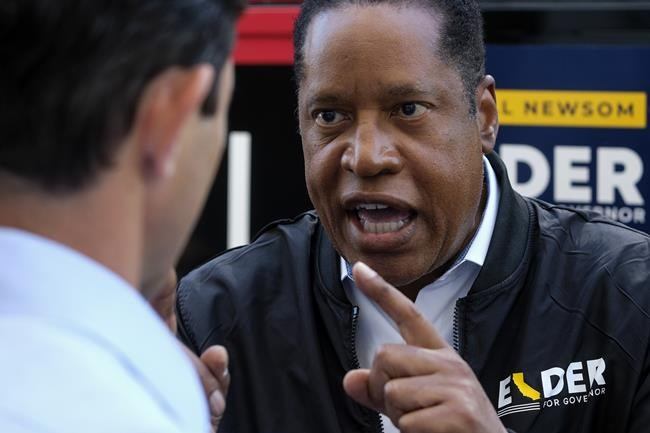 Republican conservative radio show host Larry Elder argues with a TV reporter during an interview after visiting Philippe The Original Deli during a campaign for the California gubernatorial recall election on Monday, Sept. 13, 2021, in Los Angeles. (AP Photo/Ringo H.W. Chiu)