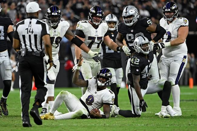 Baltimore Ravens quarterback Lamar Jackson (8) reacts after a play against the Las Vegas Raiders during the second half of an NFL football game, Monday, Sept. 13, 2021, in Las Vegas. (AP Photo/David Becker)