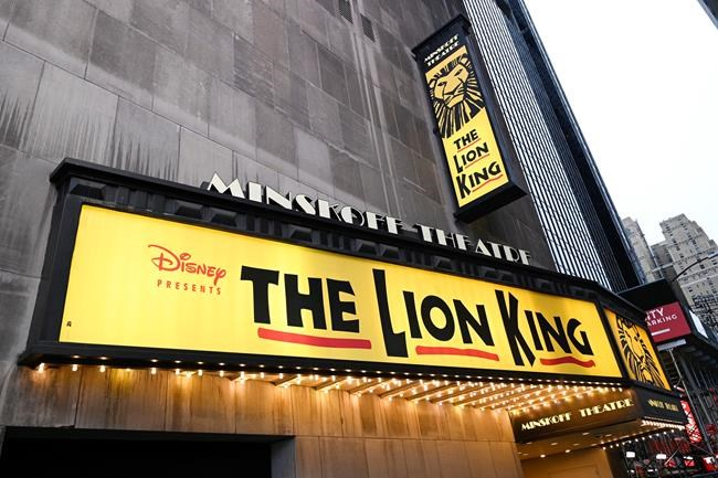 """FIle - The Minskoff Theatre, home f the musical """"The Lion King,"""" appears on May 24, 2021 in New York. Theaters for """"The Lion King,"""" """"Hamilton"""" and """"Wicked"""" all set to reopen on Tuesday. (Photo by Evan Agostini/Invision/AP, File)"""