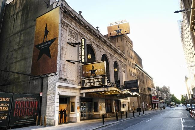 """FILE - The Richard Rodgers Theatre, home of the musical """"Hamilton,"""" appears closed during Covid-19 lockdown in New York on May 13, 2020. Theaters for """"The Lion King,"""" """"Hamilton"""" and """"Wicked"""" are set to reopen on Tuesday. (Photo by Evan Agostini/Invision/AP, File)"""