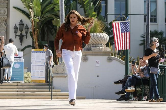 Caitlyn Jenner, gubernatorial candidate, leaves after casting her ballot for the California recall election at a vote center at City Hall in Beverly Hills, Calif., on Tuesday, Sept. 14, 2021. (AP Photo/Ringo H.W. Chiu)