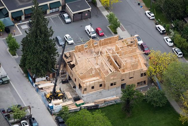 A multi-family home is seen under construction in an aerial view, in Langley, B.C., on Wednesday May 16, 2018. THE CANADIAN PRESS/Darryl Dyck
