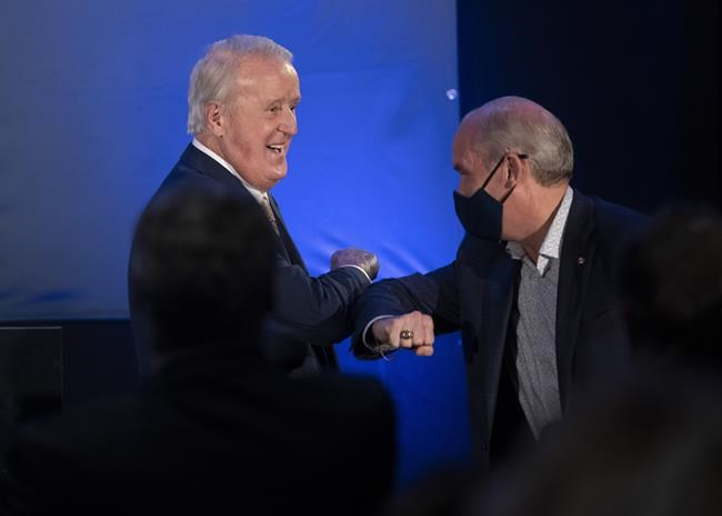 Conservative Leader Erin O'Toole is introduced by former prime minister Brian Mulroney during a campaign rally Wednesday, September 15, 2021 in Orford, Que. THE CANADIAN PRESS/Adrian Wyld
