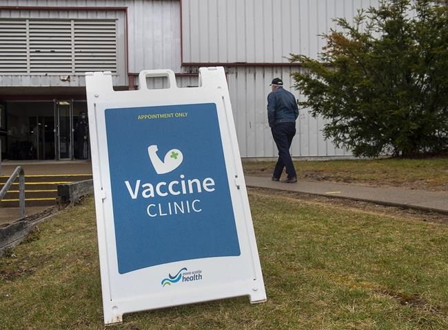 A man heads to receive a COVID-19 vaccination at a clinic in Halifax on April 16, 2021. THE CANADIAN PRESS/Andrew Vaughan