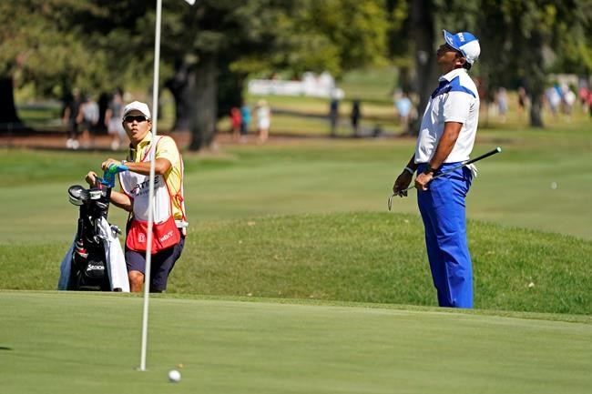 Hideki Matsuyama, right,of Japan, reacts after missing a hit for birdie on the sixth green of the Silverado Resort North Course during the final round of the Fortinet Championship PGA golf tournament Sunday, Sept. 19, 2021, in Napa, Calif. (AP Photo/Eric Risberg)
