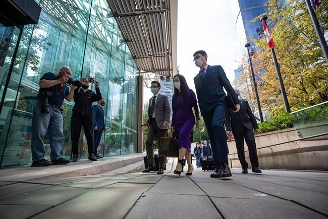 Meng Wanzhou, second right, chief financial officer of Huawei, returns to B.C. Supreme Court after a break from her extradition hearing in Vancouver on Wednesday, August 18, 2021. THE CANADIAN PRESS/Darryl Dyck