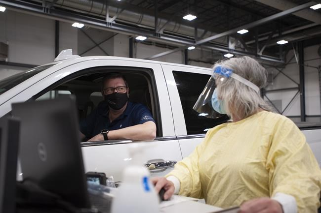 Saskatchewan Premier Scott Moe registers for a dose of the Pfizer-BioNTech vaccine at a COVID-19 vaccination drive-thru clinic at Evraz Place in Regina on Thursday, April 15, 2021. THE CANADIAN PRESS/Mark Taylor