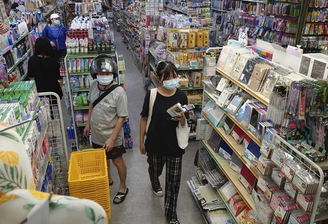 People wear face masks to protect against the spread of the coronavirus as they shop in Taipei, Taiwan, Sunday, Sept. 26, 2021. (AP Photo/Chiang Ying-ying)