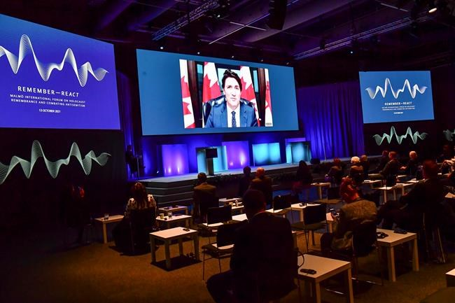 Prime Minister Justin Trudeau speaks via video link during the International Forum on Holocaust Remembrance and Combatting Antisemitism, in Malmö, Sweden, Wednesday, Oct. 13, 2021. The one-day conference focuses on the receding memory of the Holocaust as Sweden marks the 20th anniversary of a conference on remembering the genocide, with participants focusing on how social media is contributing to a rise in antisemitism. THE CANADIAN PRESS/Jonas Ekströmer/TT via AP