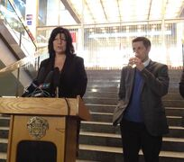 Winnipeg Mayor Brian Bowman drinks a glass of tap water as Diane Sacher, director of the city's water and waste department speaks Thursday at a press conference announcing the boil-water advisory had been lifted.