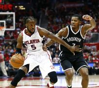 FILE - In this Sunday, April 19, 2015, file photo, Atlanta Hawks forward DeMarre Carroll (5) drives against Brooklyn Nets forward Joe Johnson (7) in the first half of an NBA playoff basketball game in Atlanta. Bouncing from team to team, Carroll never doubted he would make it in the NBA. After all, he'd already endured a brother's death, being shot and a rare liver disease. Now, he's at the very core of the top-seeded Hawks. (AP Photo/John Bazemore, File)