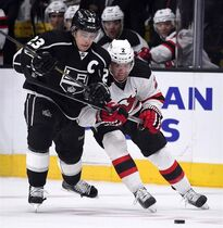Los Angeles Kings right wing Dustin Brown, left, and New Jersey Devils defenceman Marek Zidlicky, of the Czech Republic, vie for the puck during the second period of an NHL hockey game, Wednesday, Jan. 14, 2015, in Los Angeles. The New Jersey Devils have traded Zidlicky to the Detroit Red Wings for a conditional draft pick. THE CANADIAN PRESS/AP/Mark J. Terrill
