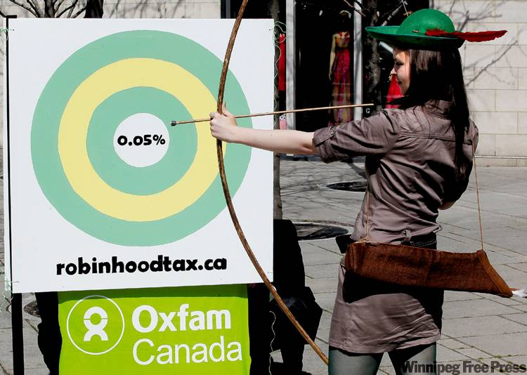 Jennifer Johnson takes aim during a demonstration in Ottawa Tuesday.
