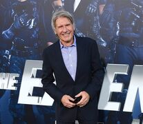 FILE - In this Aug. 11, 2014 file photo, Harrison Ford arrives at the premiere of