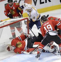 Chicago Blackhawks goalie Scott Darling falls backward into the net after stopping a shot by Nashville Predators left wing James Neal in the second period in Game 4 of an NHL Western Conference hockey playoff series against the Nashville Predators on Tuesday, April 21, 2015, in Chicago. (Daily Herald/John Starks via AP)